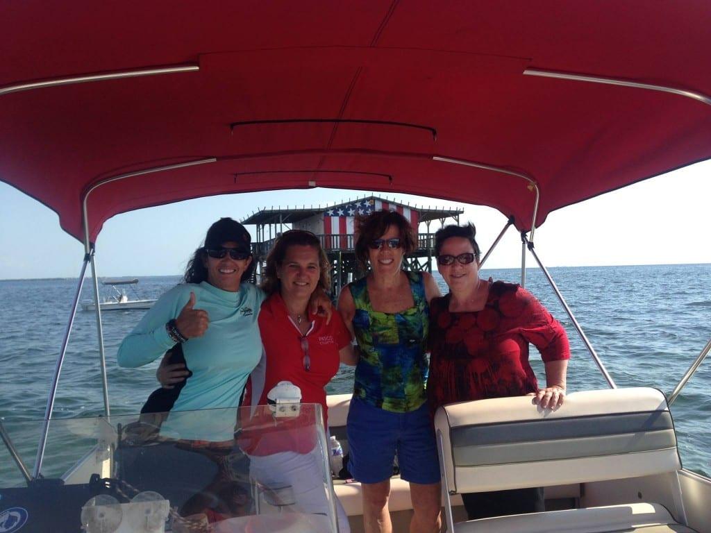 "Captain ""Shell"" Marinaro, Marla Chancey, Robin Draper and Diane Bedard enjoying the Gulf of Mexico on their way back to Gill Dawg's Marina."